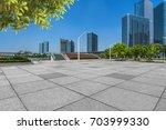 empty pavement and modern... | Shutterstock . vector #703999330