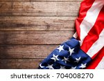 american flag on a old wooden | Shutterstock . vector #704008270