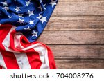 american flag on a old wooden | Shutterstock . vector #704008276