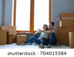 couple moving in house sitting... | Shutterstock . vector #704015584