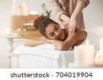 tender african girl smiling... | Shutterstock . vector #704019904