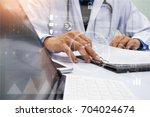 medicine doctor in white gown...   Shutterstock . vector #704024674