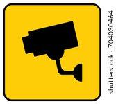 video surveillance sign yellow. ... | Shutterstock .eps vector #704030464