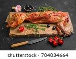 roast baked whole rabbit on... | Shutterstock . vector #704034664