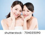 two beauty woman with healthy... | Shutterstock . vector #704035090