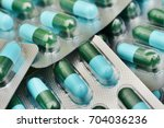 close up of a blue capsules... | Shutterstock . vector #704036236