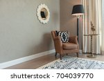 classic chair style with lamp... | Shutterstock . vector #704039770