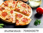 pepperoni pizza   fresh... | Shutterstock . vector #704043079