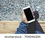 woman using smart phone | Shutterstock . vector #704046304