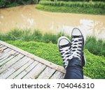 selfie of sneakers | Shutterstock . vector #704046310