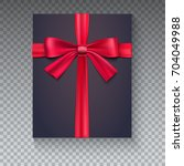 black gift box with red ribbon...   Shutterstock .eps vector #704049988