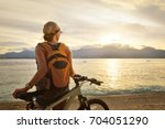 woman with backpack standing on ...   Shutterstock . vector #704051290