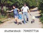 happy family with dog walking... | Shutterstock . vector #704057716