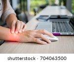 closeup woman holding her wrist ...   Shutterstock . vector #704063500