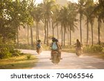 tourists travelling on scooters ... | Shutterstock . vector #704065546
