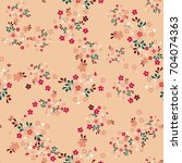 cute pattern in small flowers.... | Shutterstock .eps vector #704074363