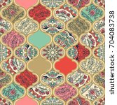seamless colorful patchwork in... | Shutterstock .eps vector #704083738