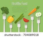 vegetables on forks. healthy... | Shutterstock .eps vector #704089018