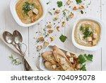 cream soup of fresh mushrooms...   Shutterstock . vector #704095078