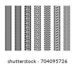 black tire tracks wheel car or... | Shutterstock .eps vector #704095726