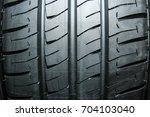 car tires for car background | Shutterstock . vector #704103040