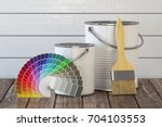 paint cans  paint brush and... | Shutterstock . vector #704103553