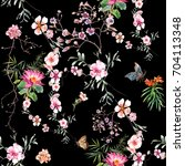 Stock photo watercolor painting of leaf and flowers seamless pattern on dark background 704113348