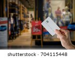 women hold credit card for... | Shutterstock . vector #704115448