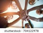 team teamwork join hands... | Shutterstock . vector #704122978