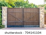 Wooden Gates With Stone Column...