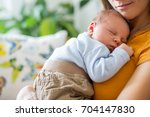 young mother  holding tenderly... | Shutterstock . vector #704147830