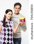 indian asian young couple... | Shutterstock . vector #704150854