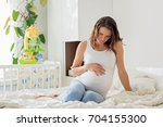 young beautiful pregnant woman  ... | Shutterstock . vector #704155300
