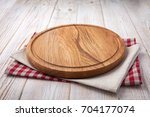 napkin and board for pizza on... | Shutterstock . vector #704177074