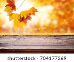 wood table top on shiny bokeh... | Shutterstock . vector #704177269