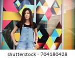 beautiful brunette on a bright... | Shutterstock . vector #704180428