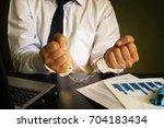 businessman in handcuffs. white ... | Shutterstock . vector #704183434