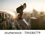 man on a rocket above new york... | Shutterstock . vector #704186779