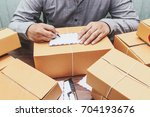 delivery man writing on... | Shutterstock . vector #704193676