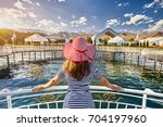 tourist woman in red hat and... | Shutterstock . vector #704197960