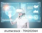 blonde businesswoman wearing a... | Shutterstock . vector #704202064