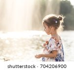 Little Cute Girl Standing At...