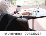 business people working outdoor.... | Shutterstock . vector #704220214