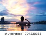 a man relax in the pool under... | Shutterstock . vector #704220388