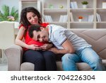 young couple family expecting a ...   Shutterstock . vector #704226304