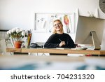 cheerful young fashion designer ... | Shutterstock . vector #704231320
