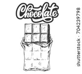 hand drawn chocolate bar with... | Shutterstock .eps vector #704239798