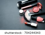 set for makeup on black... | Shutterstock . vector #704244343