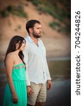 a young woman and her husband... | Shutterstock . vector #704244826