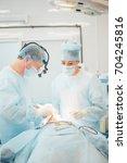 another surgery. surgery... | Shutterstock . vector #704245816